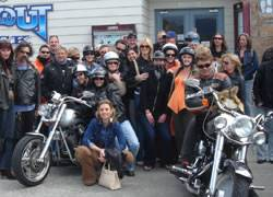 A group of people and two Harley Davidson morocycles